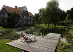 Bauernhaus mit Schwimmteich nachher